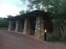 Southwestern style pergola with river rock columns with Palo Verde trees all around.